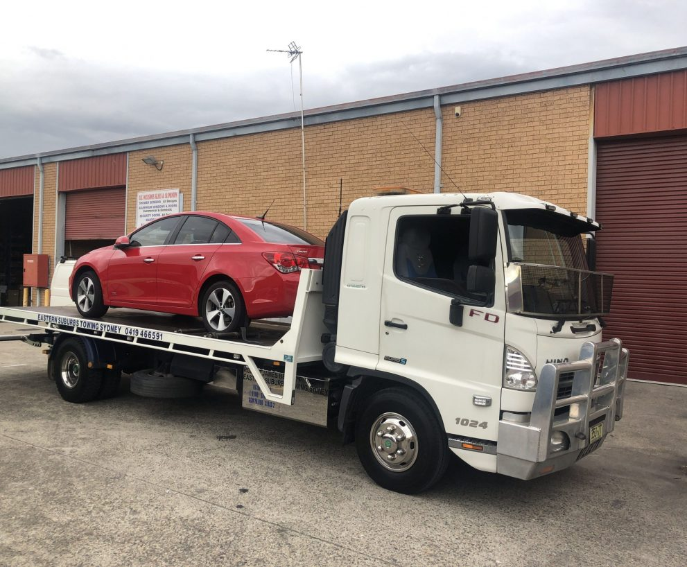 Opting For Flatbed Towing Before an Extended Trip
